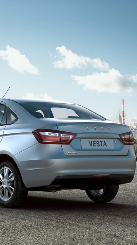 Картинка Lada Веста, серый, стопы, колеса, дорога, электростанция, небо 480x854 на телефон